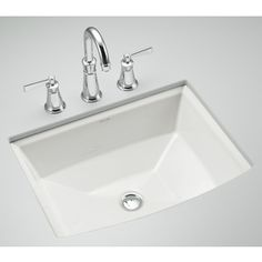 An undermount rectangle sink; considered a mid-range upgrade from the cheaper drop-in. Also, most of the bathroom designs wth granite tops seem to have this style vs drop in