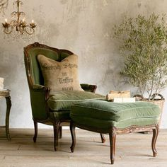 french green chair and ottoman. upholstery worn with character in such a comfy color.