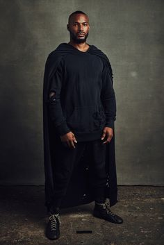 "Greg Lauren Fall 2016 Menswear | ""the ""Hero,"" a much-photographed Tyson Beckford in a gnashed caped hoodie ('he's been bruised, he's been battered, but he still has his confidence,' said Beckford of his Superman persona)..."""