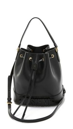 Loved my bucket bag but I had it so long it's worn. I really like this one except for the huge brand name on the bottom.... will consider saving for this one.