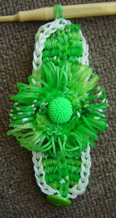 """UPDATED. Rainbow Loom WIDE FLOWER (temp name) Bracelet. Designed and loomed by Stephanie and Chloe Raboy. Stephanie said: """"Chloe and I have combined techniques from several tutorials."""" Click photo for YouTube tutorial for the flower. 02/28/14."""