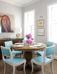 wood table with white & blue chairs