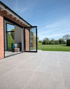 Pebble Grey porcelain stone pavers available for outdoor paving. Order your FREE sample of Pebble Grey porcelain stone tiles today! Paving Stone Patio, Outdoor Paving, Patio Slabs, Patio Tiles, Outdoor Stone, Outdoor Flooring, Concrete Patio, Indoor Outdoor, Outdoor Wood Tiles
