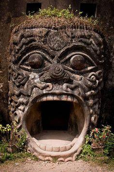 "A detail of a large sculpture in the ""Buddha Park"" created by Thai sculptor Bunleua Sulila."
