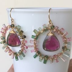 Beautiful AAA grade tourmaline crystal sticks are showcase in this earrings design showing pink to green colour gradient. Striking colour Watermelon Tourmaline slice add a pop of colour to the earrings.