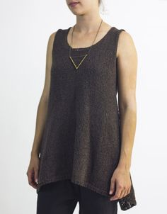 cocoknits Maude is a fun layering piece. From the front she's a simple tunic with optional pockets lined in sock weight yarn to reduce bulk. The back is open and the straps cross at the top. Very slee