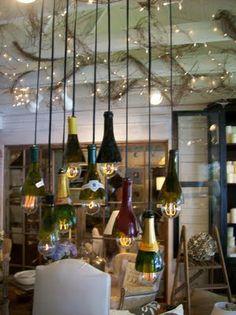 http://thepineappleroom.blogspot.com/2011/06/wine-bottle-chandelier.html