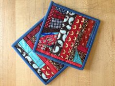 Square crazy patch pot holders / hot pads : blue, red, and brown on Etsy, $10.50