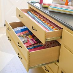 Store gift wrapping supplies in an old dresser- clutter is hidden away and you can use the dresser top to wrap your packages
