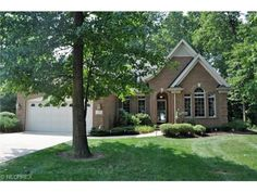 ANOTHER LISTING BY BEV MONTGOMERY:Absolutely breathtaking detached cluster on a very private wooded lot in the Prestigious gated development of Legacy Pointe, AVON LAKE , OHIO... Dramatic and open floor plan with gorgeous architectural details!