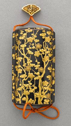 A gilt and black lacquer five-case inro 19th century Decorated in gold…