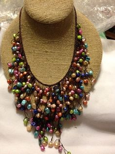 """This necklace can be worn at 18"""" or 20. It is made with cotton/poly thread with freshwater Pearls.  Appears to be a crocheted base strand that has strands of the thread knotted with the pearls hanging from the crocheted part.  $45"""