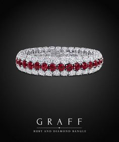 A striking yet simple bangle incorporating two rows of 66 lustrous brilliant cut white diamonds embracing a single row of 33 rich and vibrant rubies.