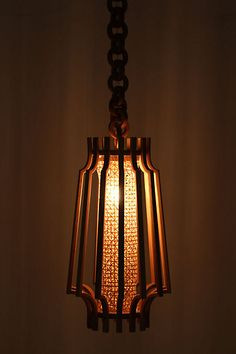 Oblong Joaquin Pendant Lamp~Natural ash wood slats curve sleekly around a rattan shade, dangling from an oversized, carved-wood chain.