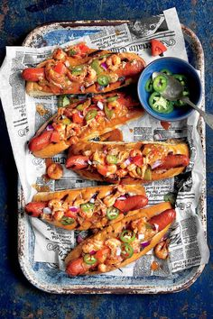 """Crawdogs"" - 32 New Orleans Classics for Mardi Gras - Southernliving. Recipe: ""Crawdogs"" Make your party menu memorable with this unique and delicious crawfish recipe. Our ""crawdog"" recipe is the perfect dish to eat for lunch the day after you serve crawfish étouffée – use your leftovers to make the best hot dog topping you've ever eaten. Simply grill some spicy hot dogs coated in Creole mustard, warm up a few fluffy hot dog buns, and then assemble the out-of-this-world hot dogs. Slather on…"