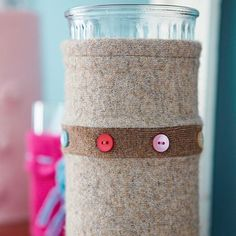 Sweater-Wrapped Vase...outgrown a favorite sweater, don't get rid of it...this is the neatest idea!