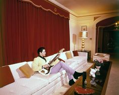 Elvis Presley's Graceland, in 1965, and playing a little bass guitar. - Google Search