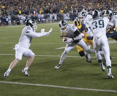 Jalen Watts-Jackson runs the ball for the game winning touchdown during the game against Michigan on Oct. 17, 2015 at Michigan Stadium. The Spartans defeated the Wolverines, 27-23.