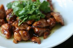Honey Soy Stir-Fried Chicken  (adapted from Kylie Kwong's Simple Chinese Cooking)  Serves 4-5    Chicken and marinade   1 1/2 lbs chicken thighs, cut into 1 inch pieces  1/4 cup honey  3 tablespoons soy sauce  2 tablespoons shao xing wine or sake  2 tablespoons finely diced or grated ginger  1/2 teaspoon sesame oil  1 pinch of black pepper    For cooking  2 tablespoons vegetable oil  1 tablespoon oyster sauce