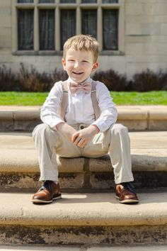 These tan suspenders and blush bow tie make a great ring bearer outfit! Ring Bearer Suspenders, Bowtie And Suspenders, Ring Bearer Outfit, Country Ring Bearers, Country Wedding Rings, Navy Rings, Bridesmaids And Groomsmen, Toddler Boys, Dream Wedding