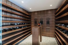 This cellar has plenty of shelves for displaying and storing wine.