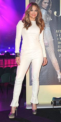 When you're J. Lo, clearly the only thing you can possibly wear for a Melbourne photo call in your honor is a white leather look with a shining cuff and coordinating heels.