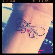 This is perfect...initials and all. this is THE ONE!!!   infinity with kids initials; tattoo inspiration. Like this! I just wouldn't get it on my wrist. Somewhere I can be able to cover it up if needed.