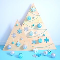 If you're looking for a fun modern alternative this Holiday season, why not make a wood Christmas tree?