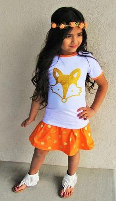 """Glitter Fox Orange Polka Dot Skirt Set How adorable is this gold fox orange gold polka dot skirt sets?! A gold glitter """"Fox"""" on the front, paired with a orange gold polka dot cotton stretchy waist skirt."""
