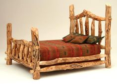 I want this bed!! It makes me think of the 3 bears!  Log Furniture - Burl Aspen 4 Post Log Bed with Elk Markings