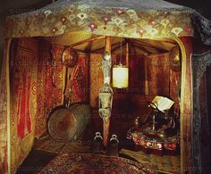 17th c. Interior of an Ottoman tent, hung with rugs. And collapsible cloth-covered lantern...