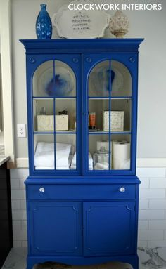 Painting an outdated china cabinet for bathroom storage/ Clockworkinteriors.com