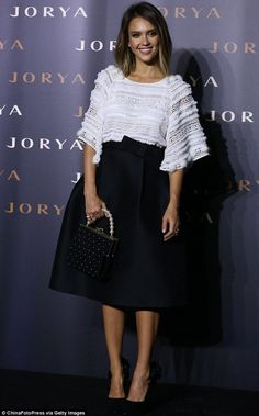 Jessica Alba was chic in a black skirt and white top as she attended a fashion event in Shanghai