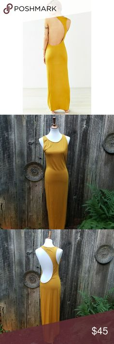 028d80931b5a8 NWOT Urban Outfitters OFU Modern Cutout Maxi Dress Never worn. No flaws  found. This is a stunning statement piece!! MAKE AN OFFER. BUNDLE AND SAVE.