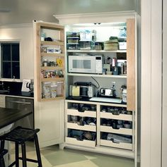 Excellent and stylish storage unit to hide all those bulky kitchen items. Helps save counter space.