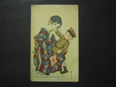 Postcard showing a mother with a child dressed in military uniform. A cap that is identical to the one the boy is wearing, is shown on this page.