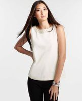 Pearlized Neck Shell - Delicate pearlized beading adorns the neckline of this swoon-worthy shell for a shimmery, snow-dusted look perfect for the season. Jewel neck. Sleeveless.
