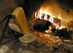 probably the best raclette picture in existence. love the old style machine.
