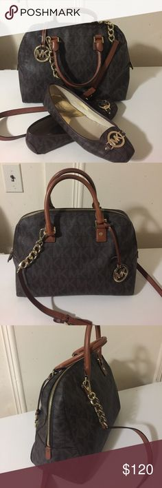 Authentic Michael Kors purse Gorgeous purse. Little stain inside as seen on pic, otherwise, good condition. Very classy purse. Just the purse, shoes not included. Can sell shoes separately. Thanks Michael Kors Bags Hobos