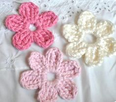 Crochet flowers 1. Ch 6. Sl st into 1st ch to form a ring.    2. **Ch 3, 2 tc into ring, ch 3, sl st into ring** 6 times for six-petal (OR only 5 times for five-petal). Fasten off and weave in ends. I sewed a button to the middle and a pin to the back. Very easy to make and comes out pretty!