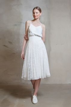 Pleated lace dress with shoulder straps from Lilli Jahilo Resort 2016