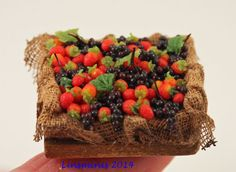 A little rustic crate of blackcurrants & strawberries