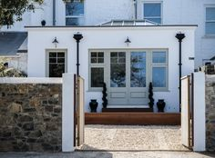 How do I hire someone to redesign my home? Extension featuring timber french doors and windows