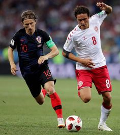 Luka Modric of Croatia and Thomas Delaney of Denmark battle for the ball during the 2018 FIFA World Cup Russia Round of 16 match between Croatia and. Soccer World Cup 2018, Fifa World Cup, Real Madrid, National Football Teams, Football Players, Celebrity Crush, Croatia, Russia, Battle
