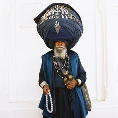 Picture of a Nihang Sikh man wearing a large head wrap, Punjab, India