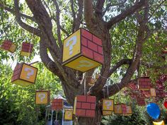 Mario themed party - question mark favor boxes hanging from a tree