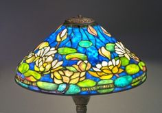 LOUIS COMFORT TIFFANY, Pond of Lily Table Lamp, stained glass, 20 3/4 inch shade and 26 1/4 inch base, Tiffany Studios: The Holtzman Collection Exhibition, Shade model #1490 and base model #368