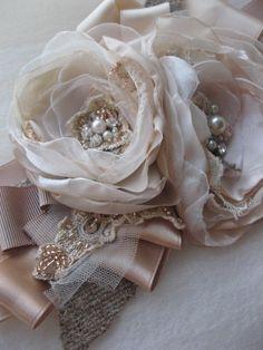 Weddings bridal sash beige, blush, taupe, and ivory layered organza flowers.