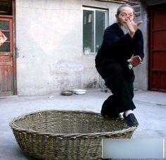 A Chinese man playing Light Kungfu...