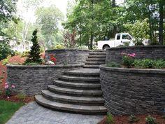Round #brick retaining #walls work as #planters too! #Pavers #steps &…
